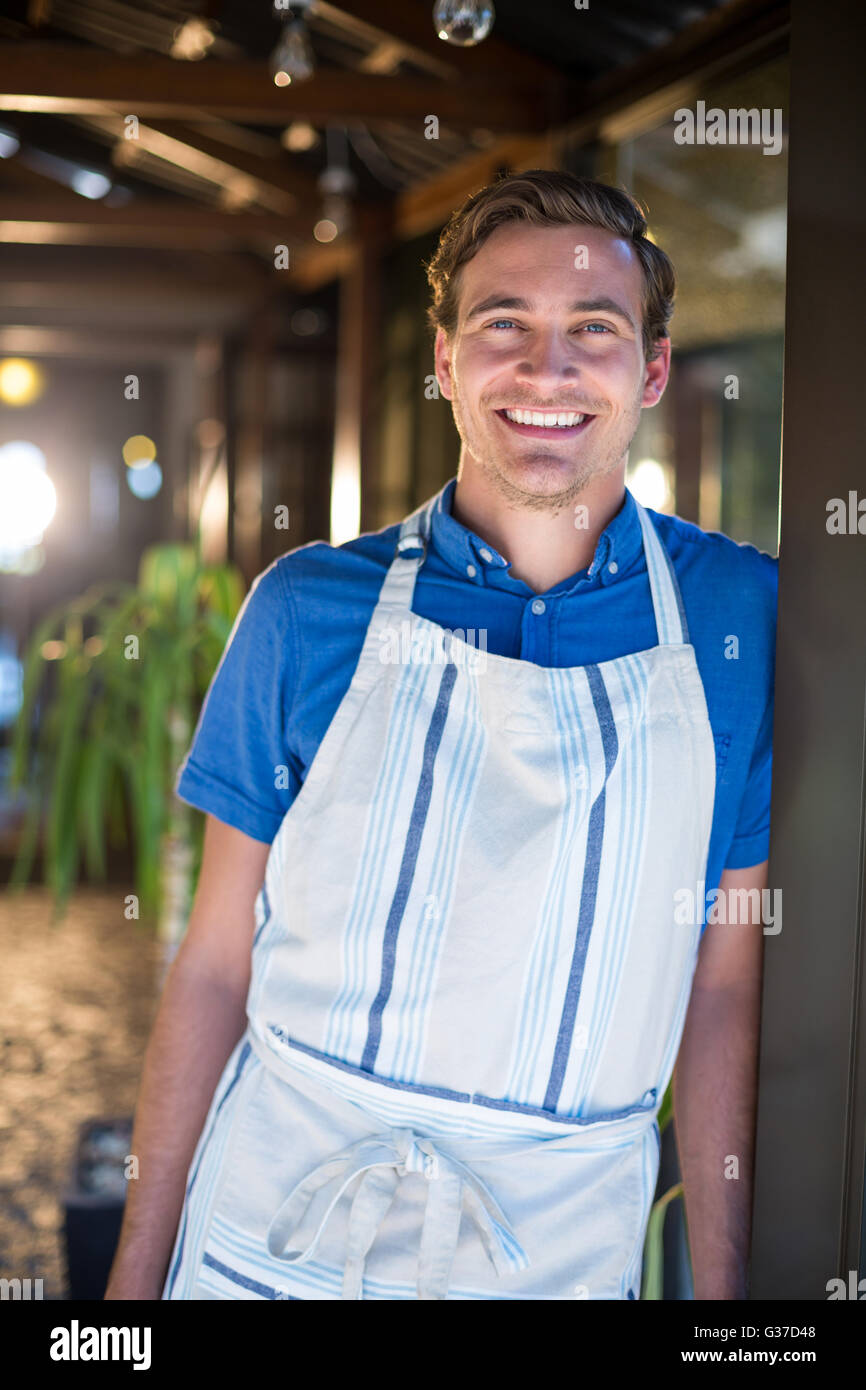 Portrait of smiling chef - Stock Image