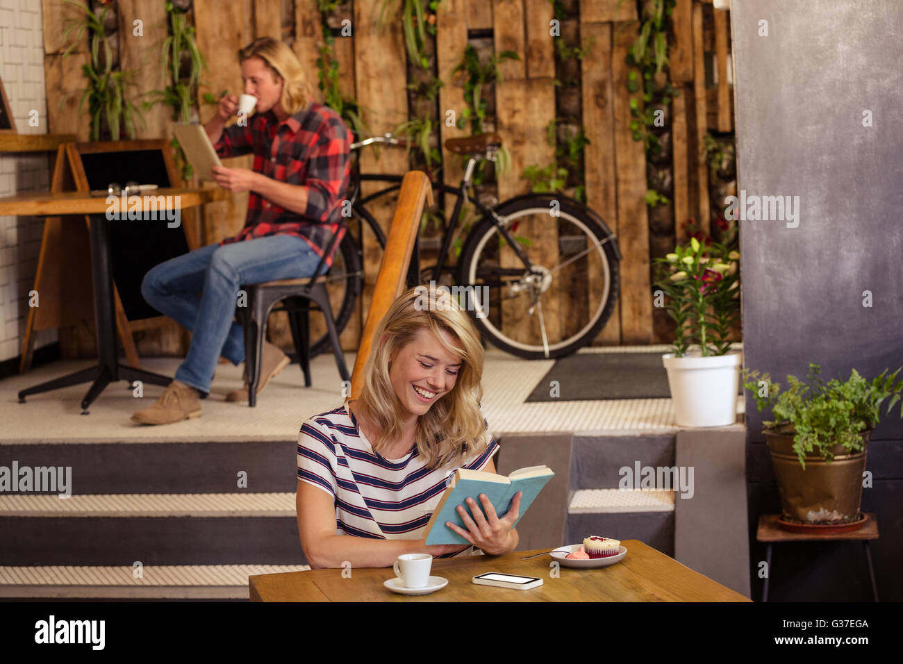 People reading book and using tablet Stock Photo