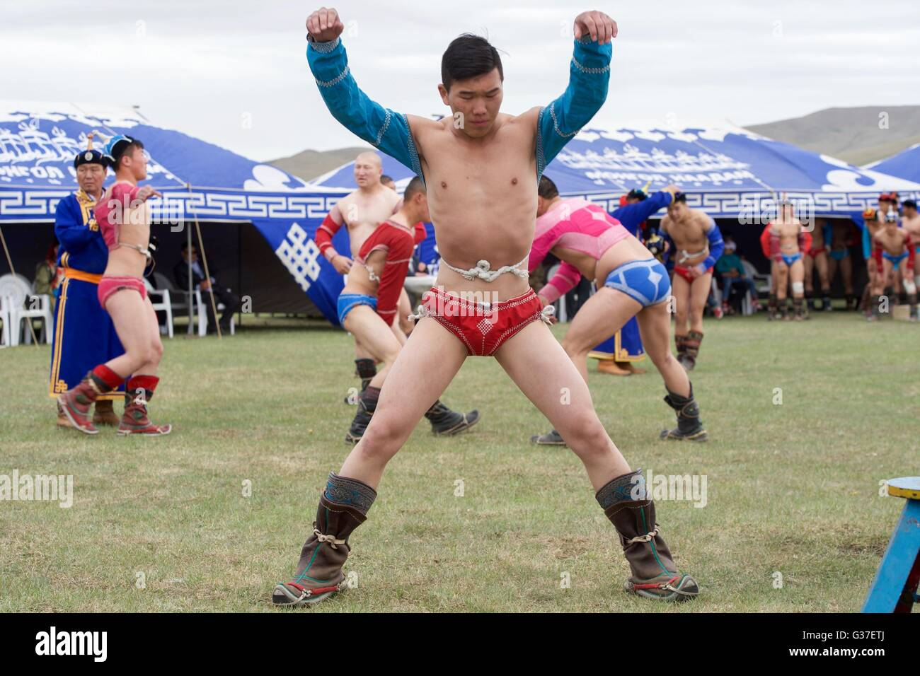 Mongolian wrestlers warm up before competition during a mini nadaam staged for visiting U.S Secretary of State John - Stock Image