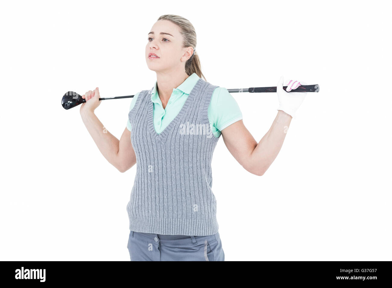 Pretty blonde posing with golf equipment - Stock Image