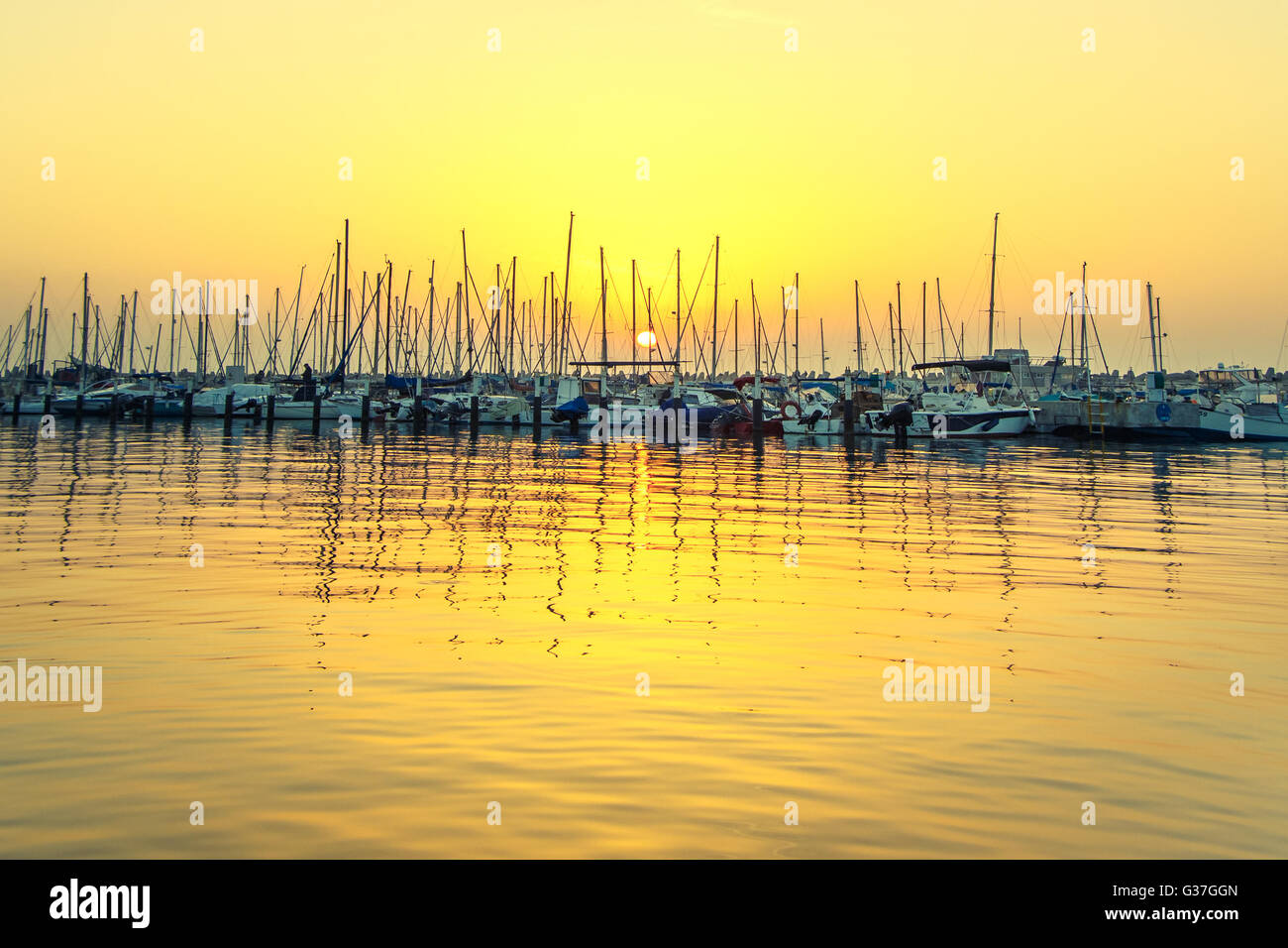 reflection in water boats. vintage filtered image - Stock Image