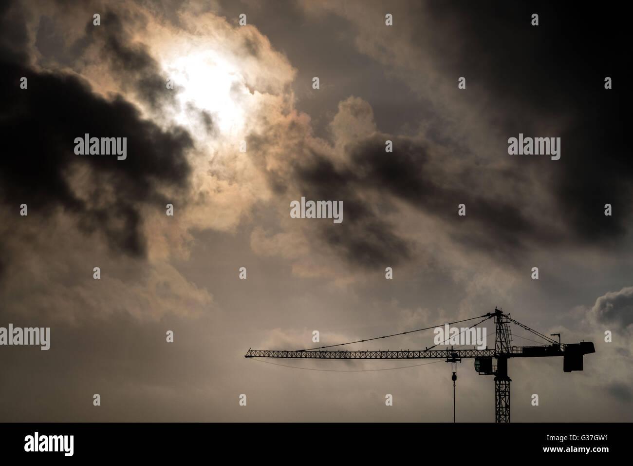Construction crane seen again the sky in Abidjan, Cote d'Ivoire. - Stock Image