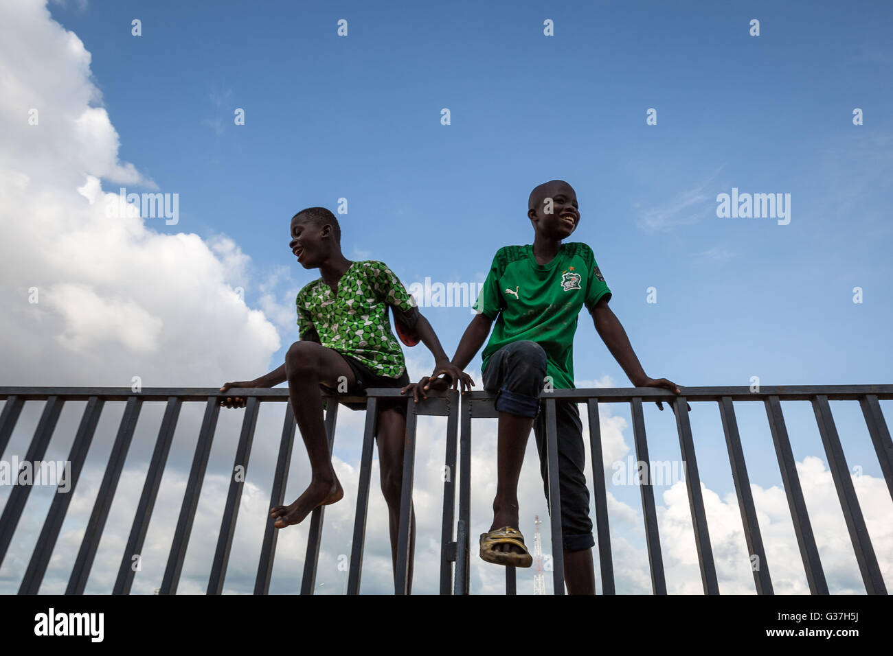 Young local boys pose for a photo in Bouaké, Côte d'Ivoire, West Africa - Stock Image