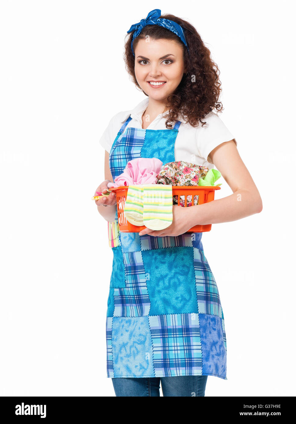 Housewife with laundry basket - Stock Image