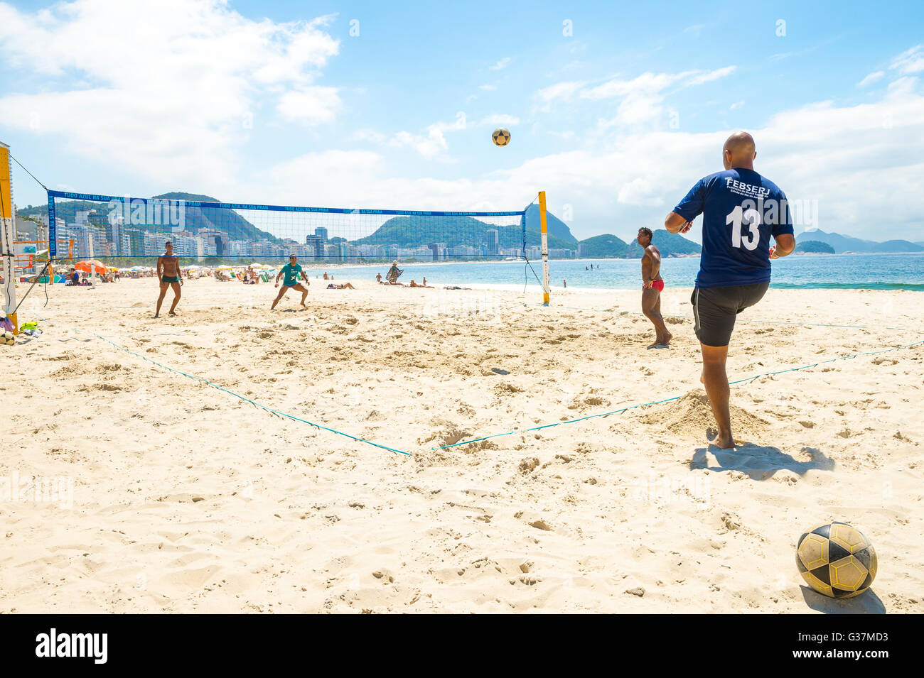 RIO DE JANEIRO - MARCH 15, 2016: Brazilian men play futevôlei (footvolley, combining football and volleyball) - Stock Image