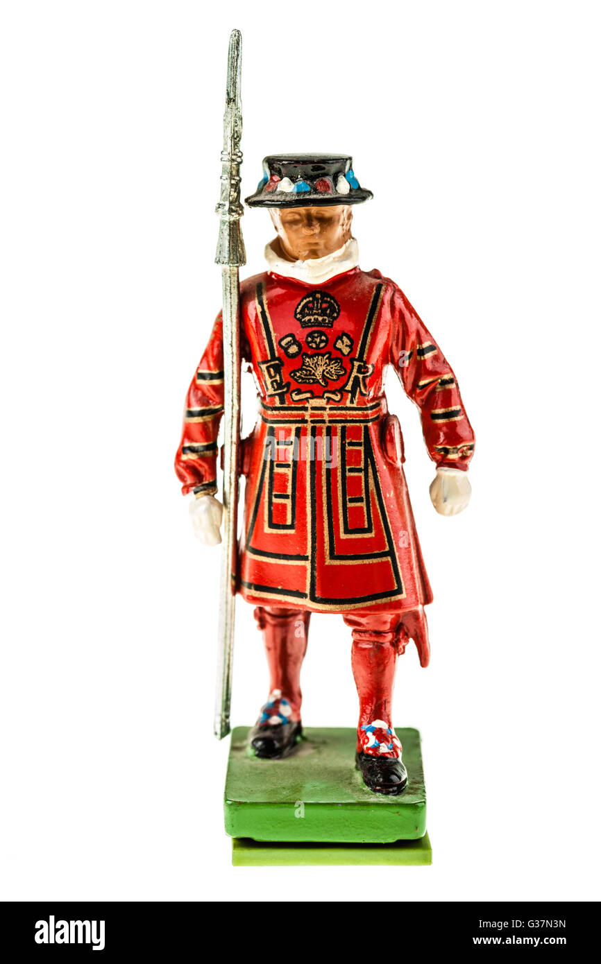 Beefeater statuette (Yeomen Warders of Fortress Tower of London) in Tudor State Dress isolated over a white background - Stock Image