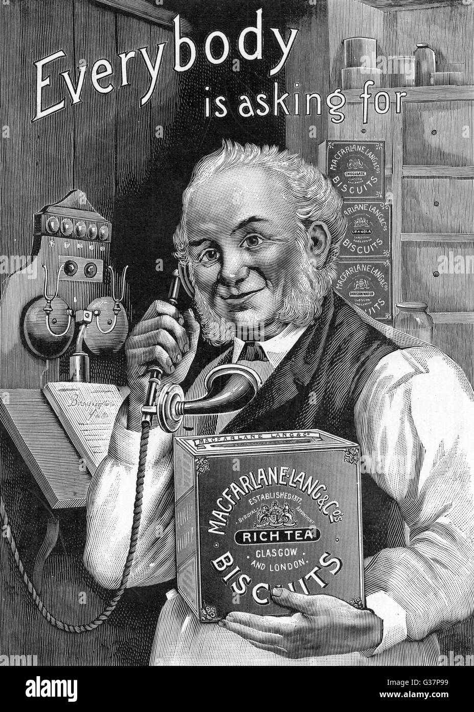 Storekeeper holds a tin of  Macfarlane Lang and Co  biscuits while he is on the  phone       Date: 1902 - Stock Image