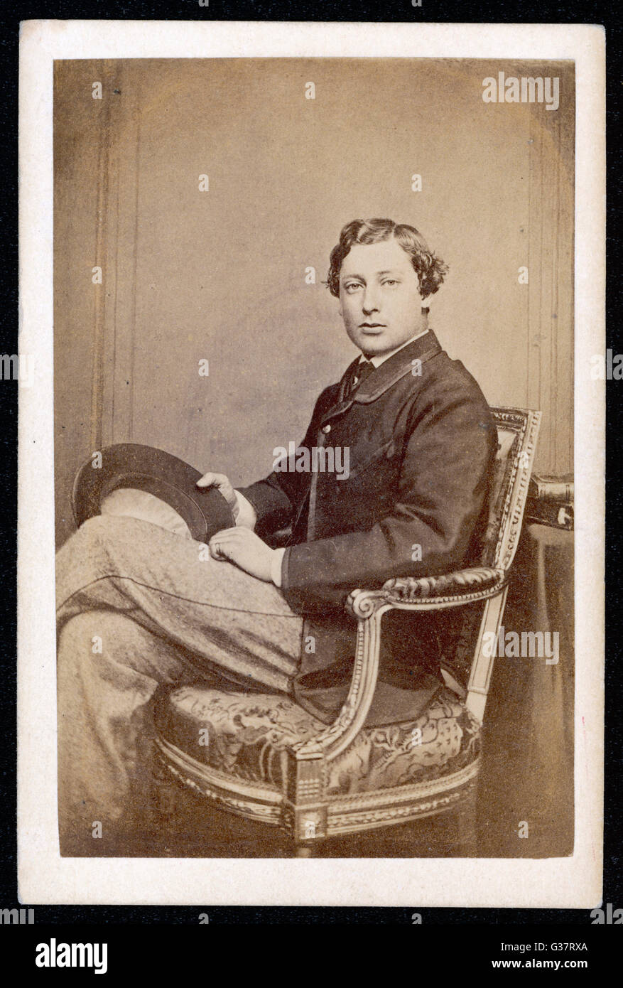 EDWARD VII, BRITISH ROYALTY as young PRINCE OF WALES  seated in relaxed pose        Date: 1841 - 1910 - Stock Image