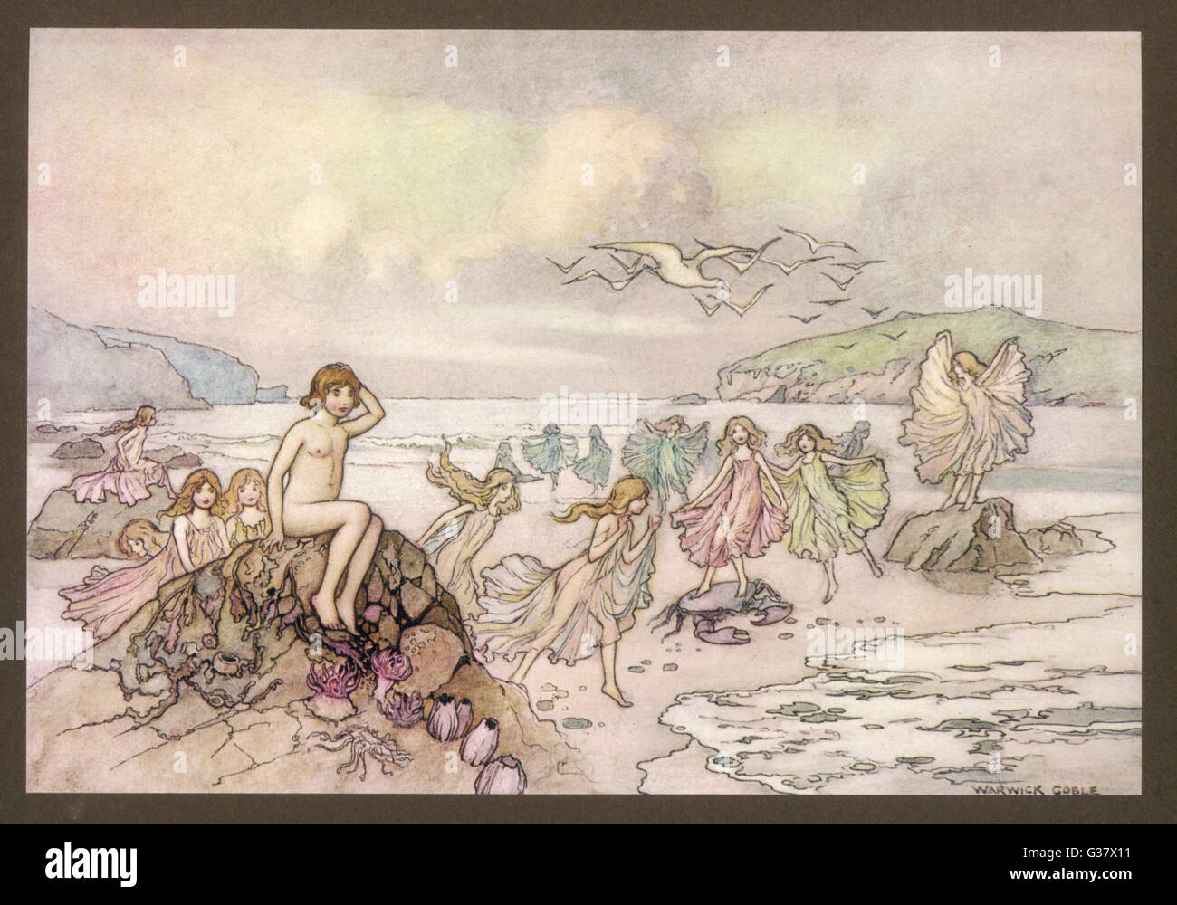 """And sit upon a point of rock,  among the shining sea-weeds""; Tom with the fairies on the  beach. - Stock Image"