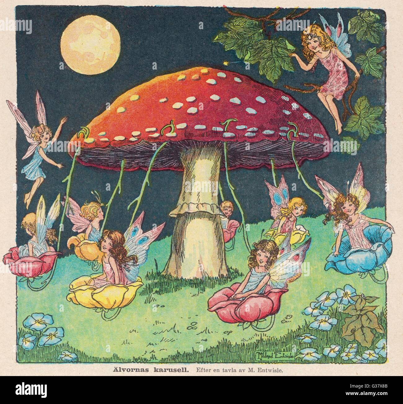 Fairies at play - a toadstool  makes a convenient merry-go- round        Date: 1927 - Stock Image