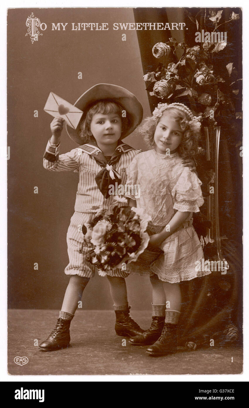 Two children carry a love letter - 'To my Little Sweetheart' Stock