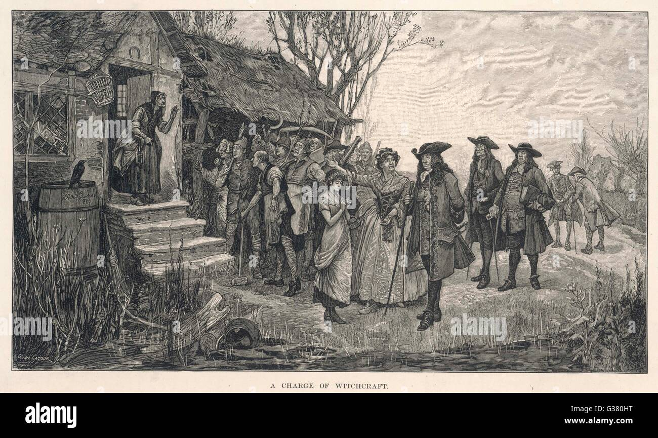 An old English cottage woman  is accused of witchcraft by  fellow villagers : the  magistrates are doubtful     - Stock Image