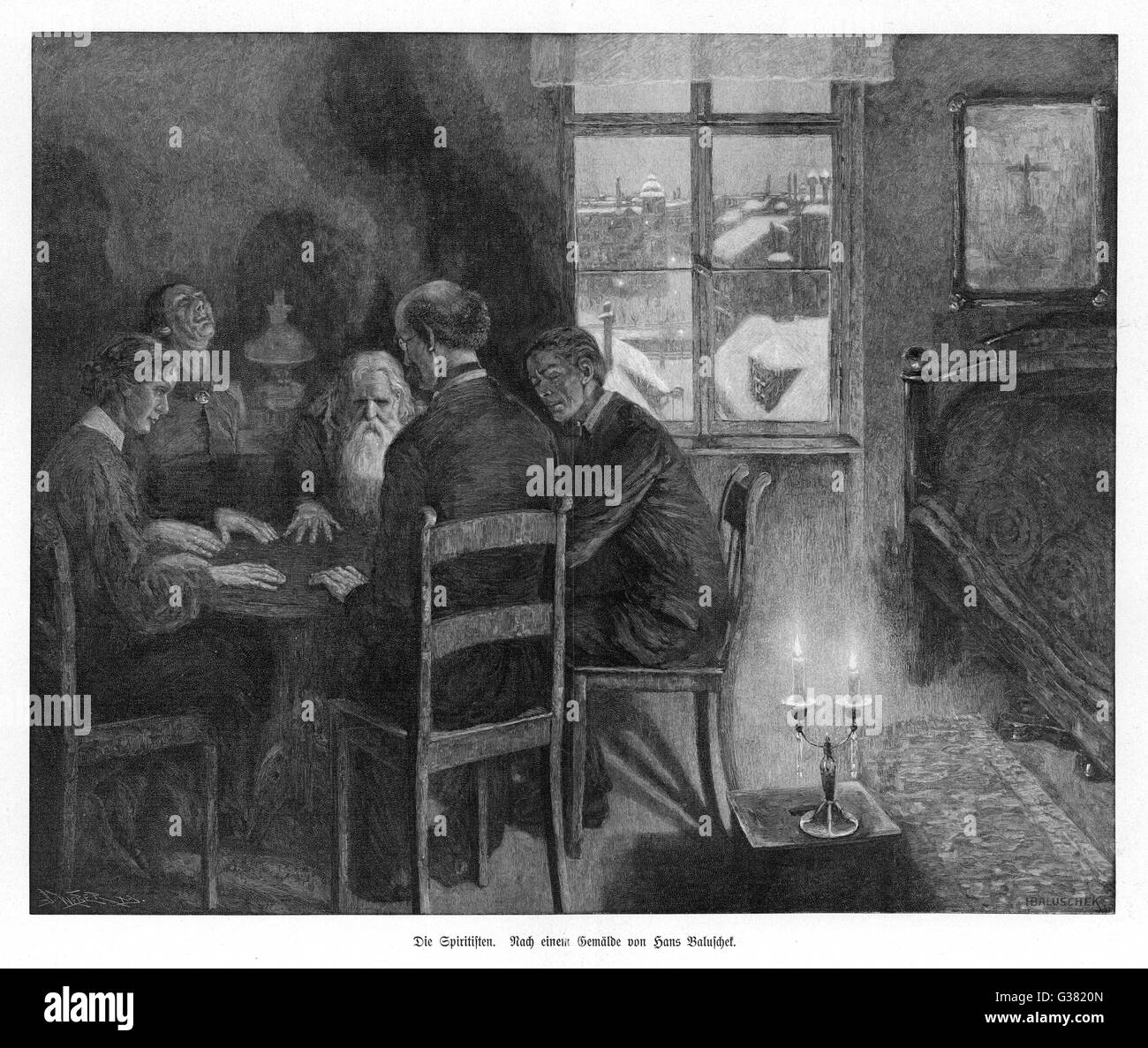 A spirit seance in a garret on  a winter evening in Germany         Date: 1906 - Stock Image
