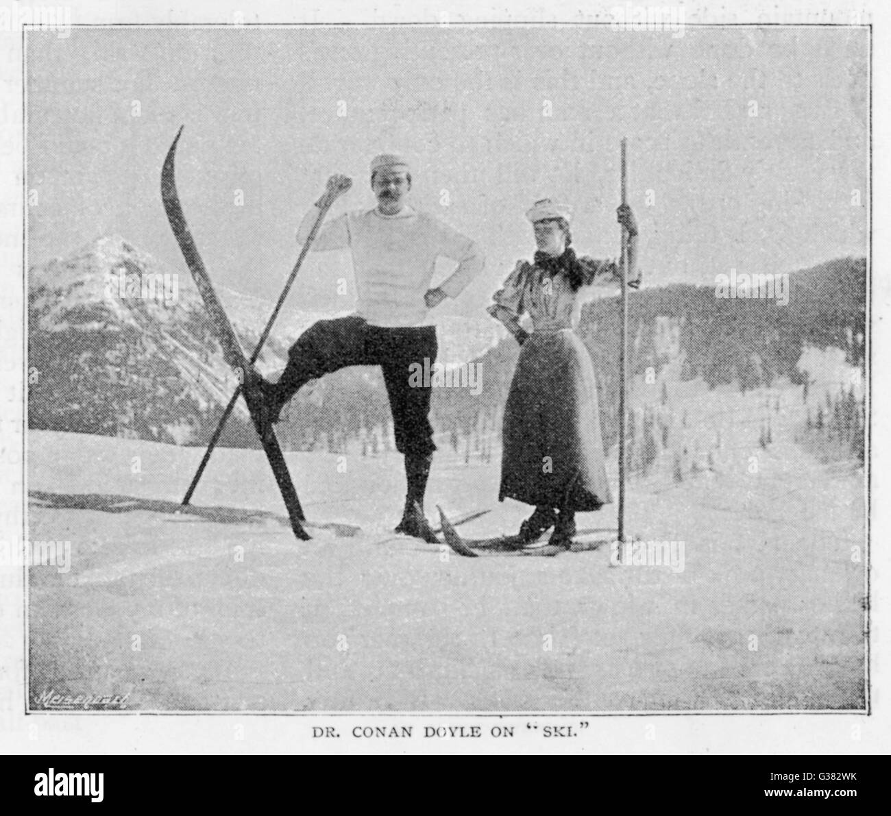 SIR ARTHUR CONAN DOYLE  In comical pose on skis in the  Alps, with female companion.       Date: 1894 - Stock Image