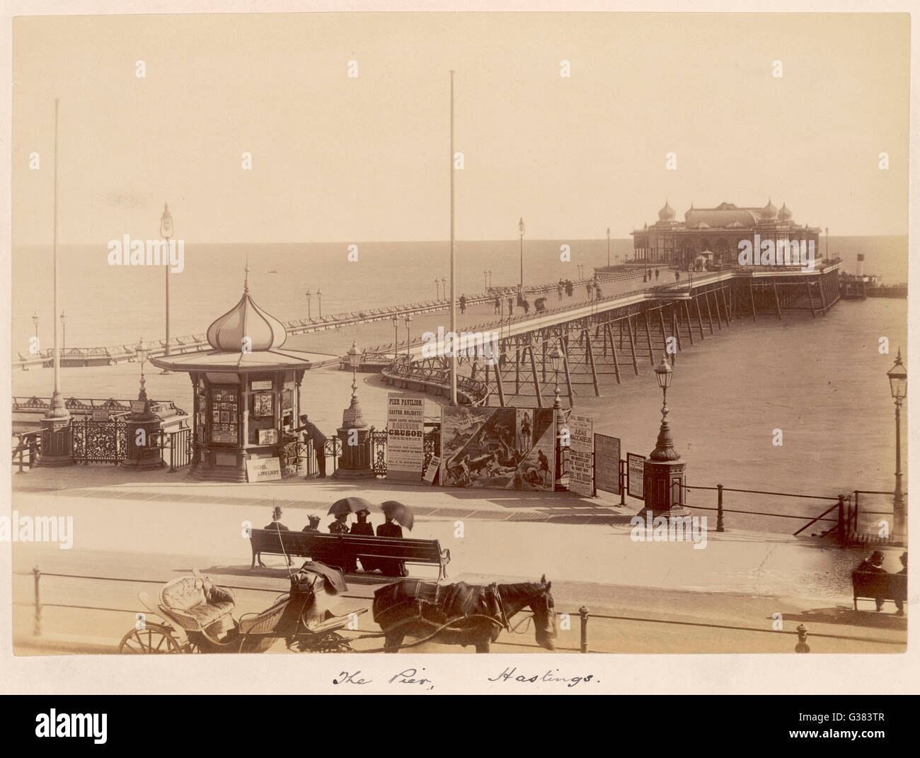 The Pier (admission 2d) with announcements of  'Robinson Crusoe', 'Judas  Maccabeus', excursions - Stock Image