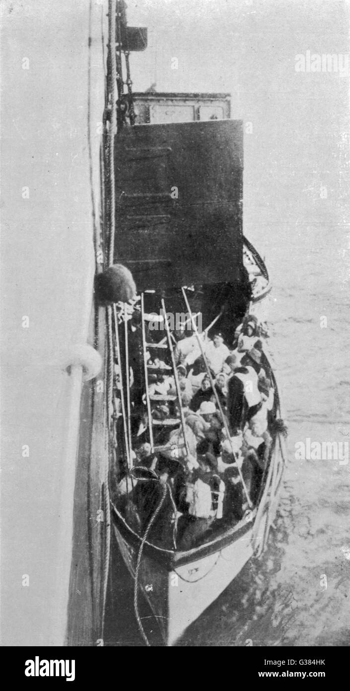 Survivors of the Titanic disaster are winched onto the  rescuing ship, the Carpathia.        Date: 1912 - Stock Image