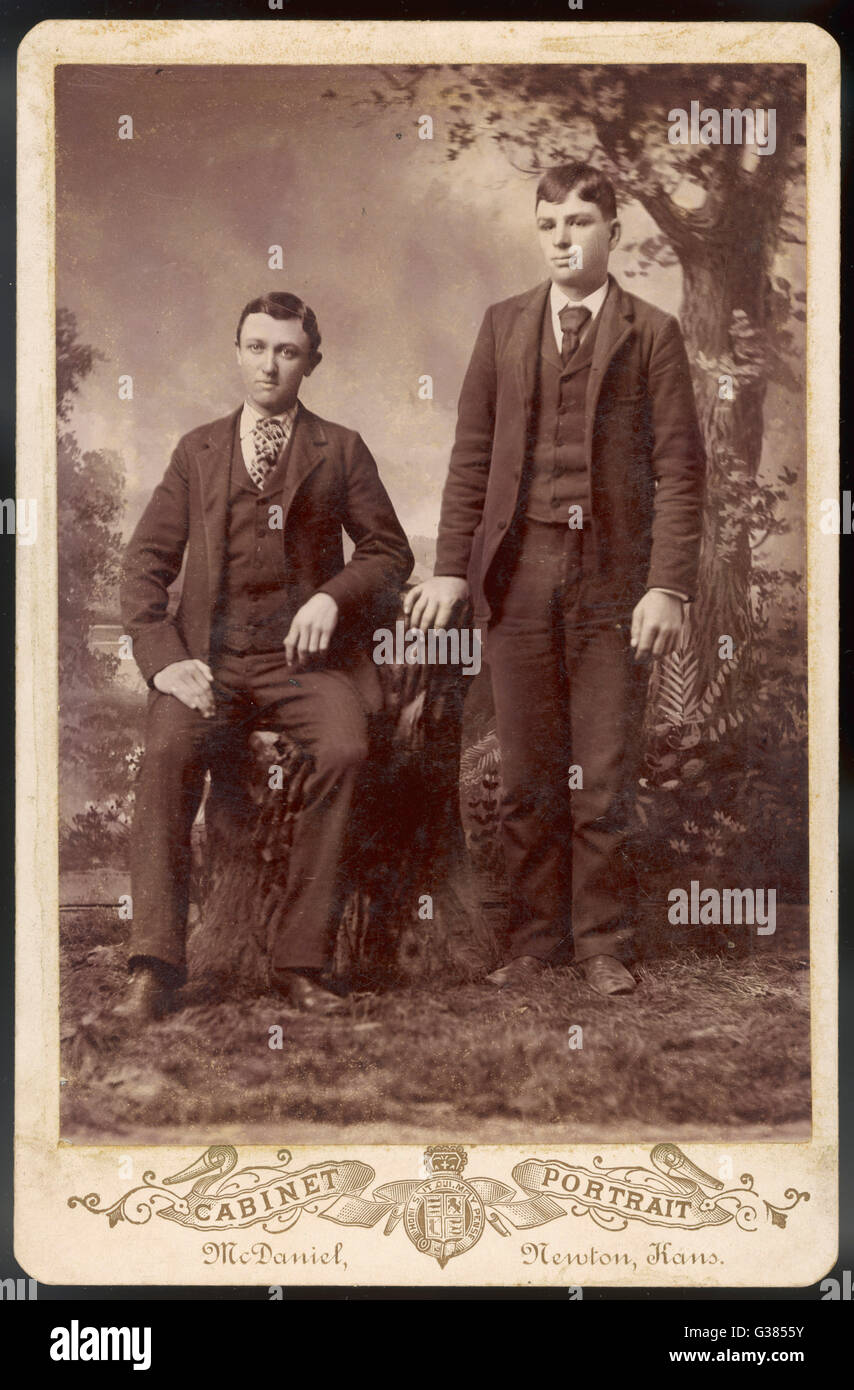 Two American brothers in a studio photograph.        Date: circa 1890 Stock Photo