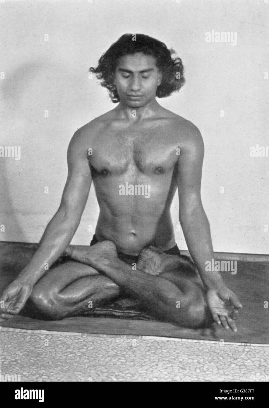 Yogi Vithaldas in the  PADMA-ASAN (Lotus pose), one of the meditative postures        Date: 1938 - Stock Image