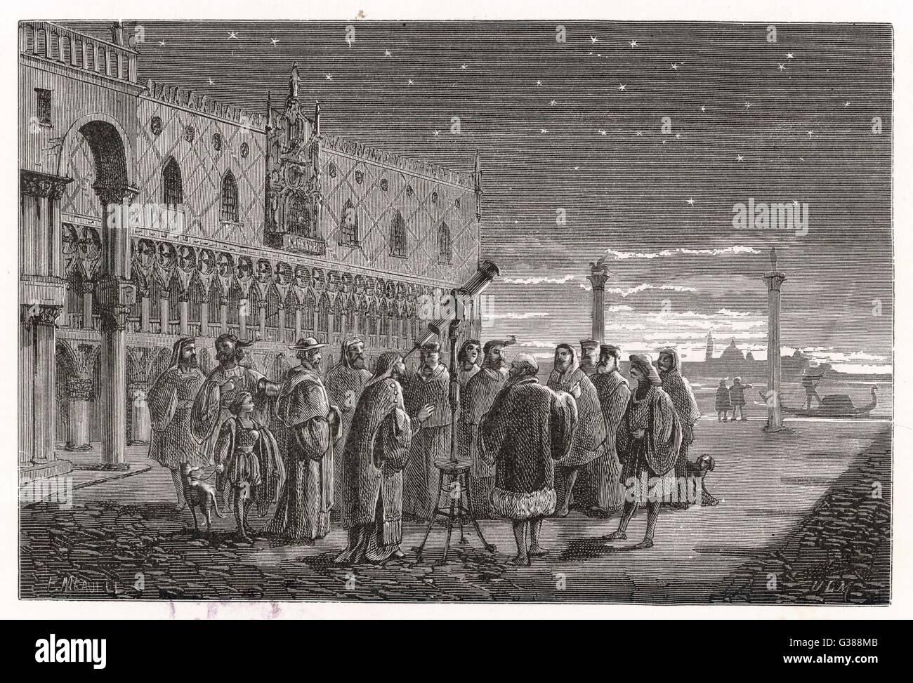 Galileo shows the satellites  of Jupiter to Venetian  senators. Stock Photo
