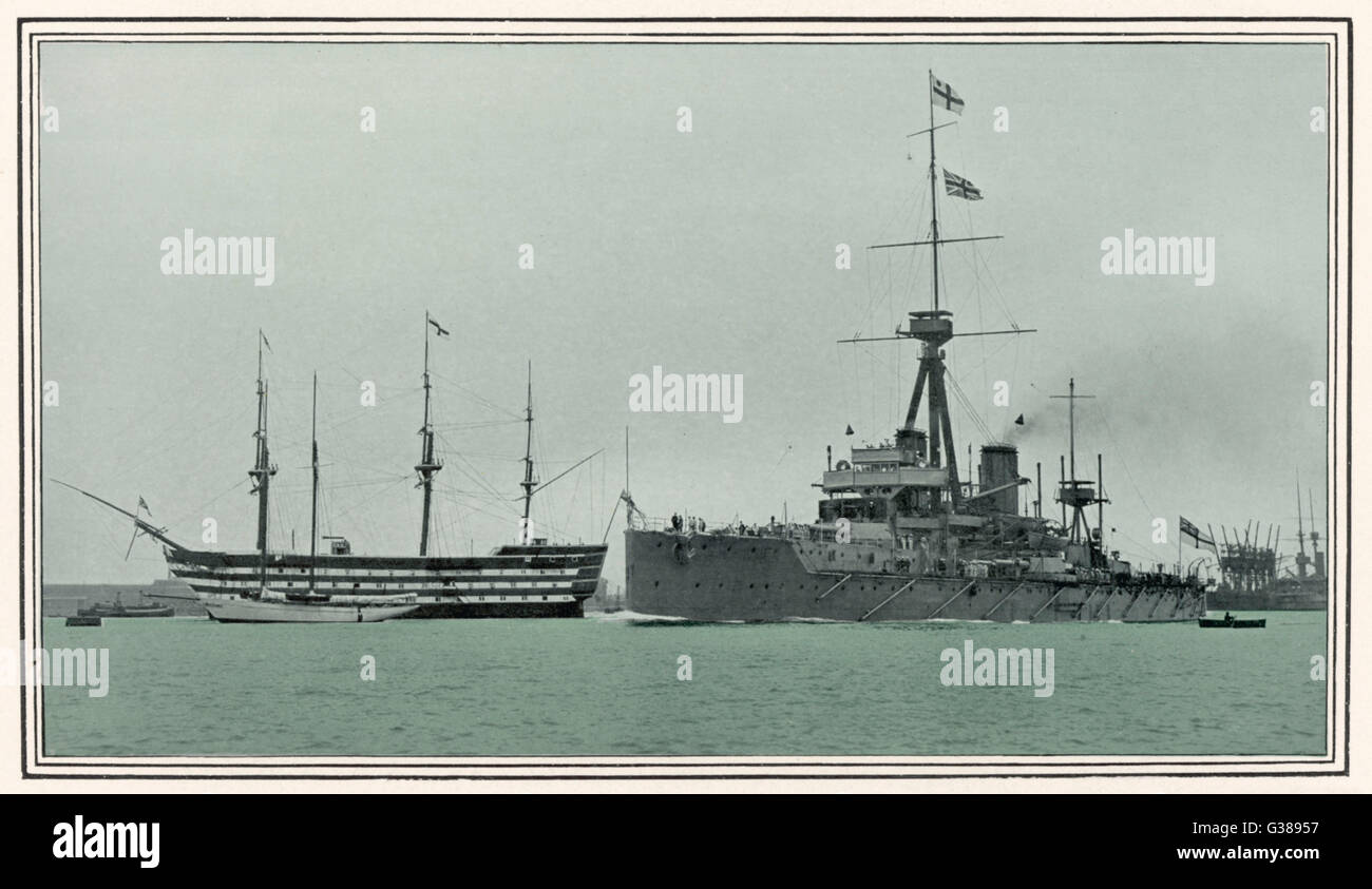 The battleship 'Dreadnought'  sails past Nelson's 'Victory'         Date: 1909 - Stock Image