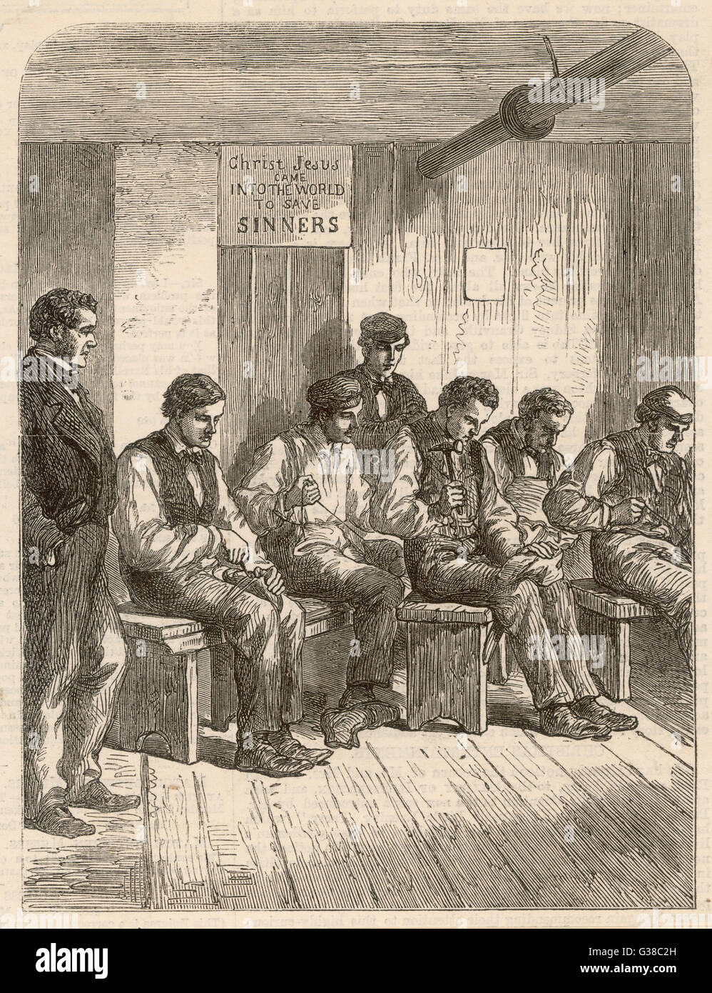Shoemaking instruction at a  Poor Law Institution        Date: 1860 - Stock Image