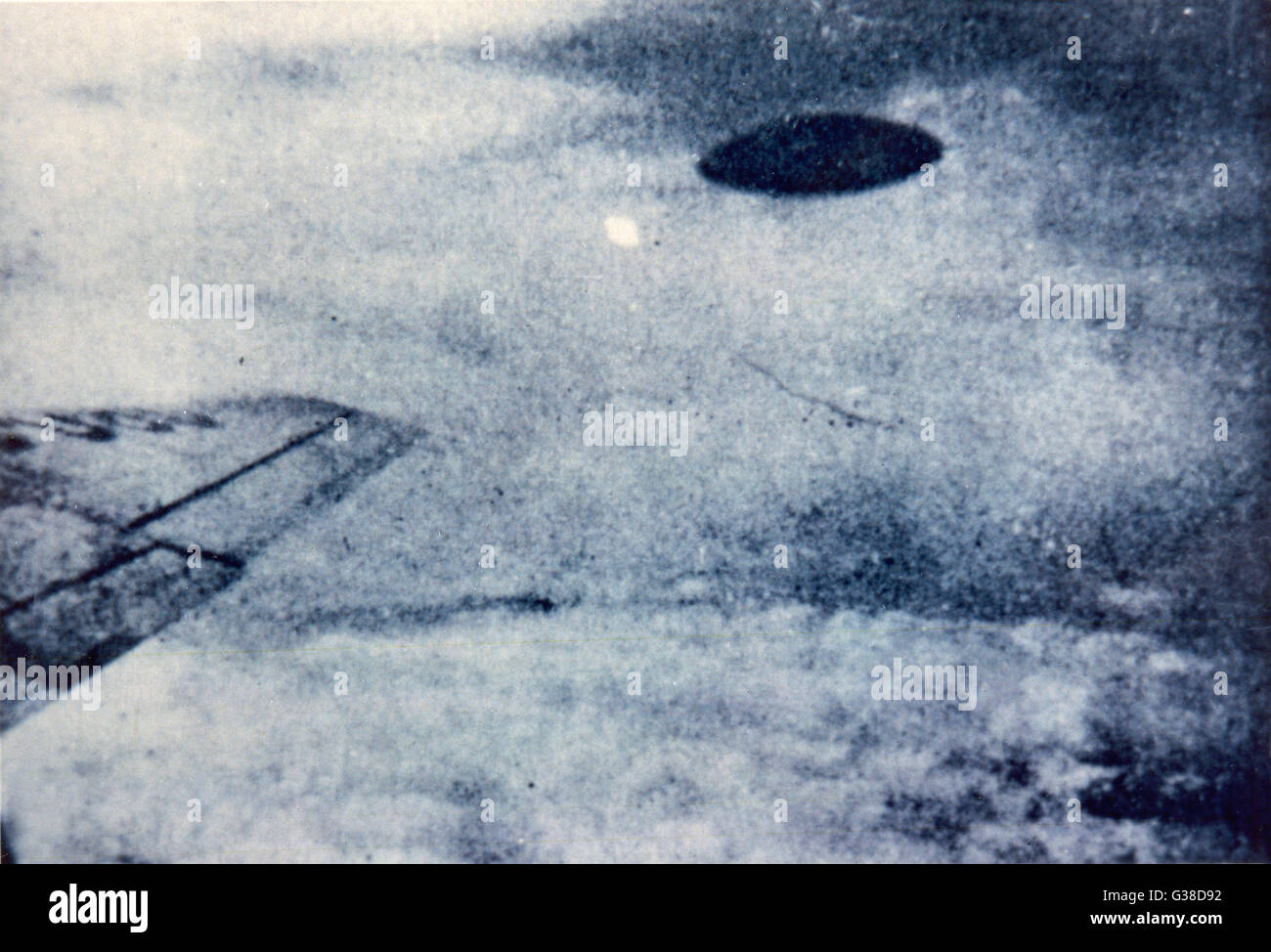 This UFO was allegedly  photographed by a passenger in  an airliner over Mexico city,  simultaneously with a power - Stock Image