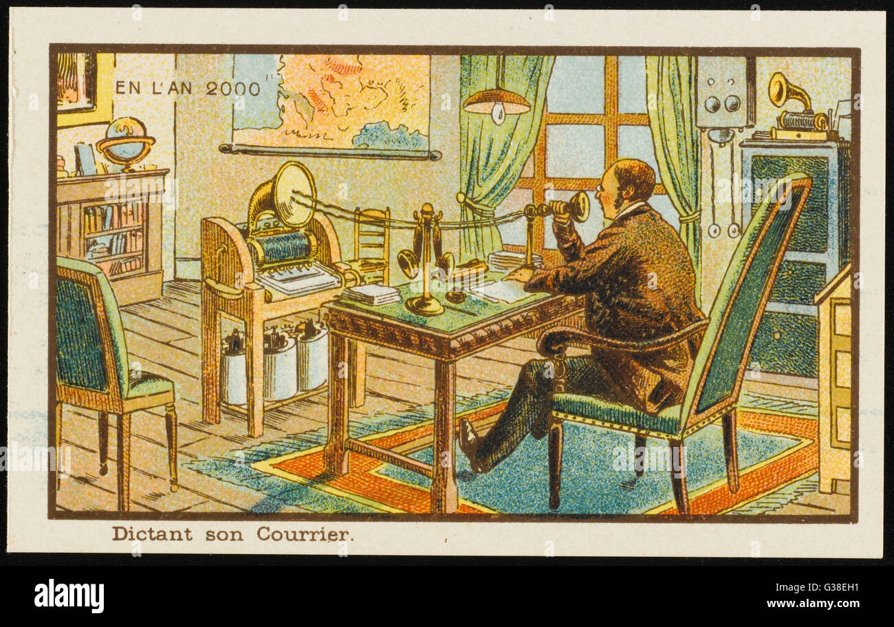A businessman of the year 2000  dictates his correspondence  into a high-tech apparatus        Date: 1899 - Stock Image