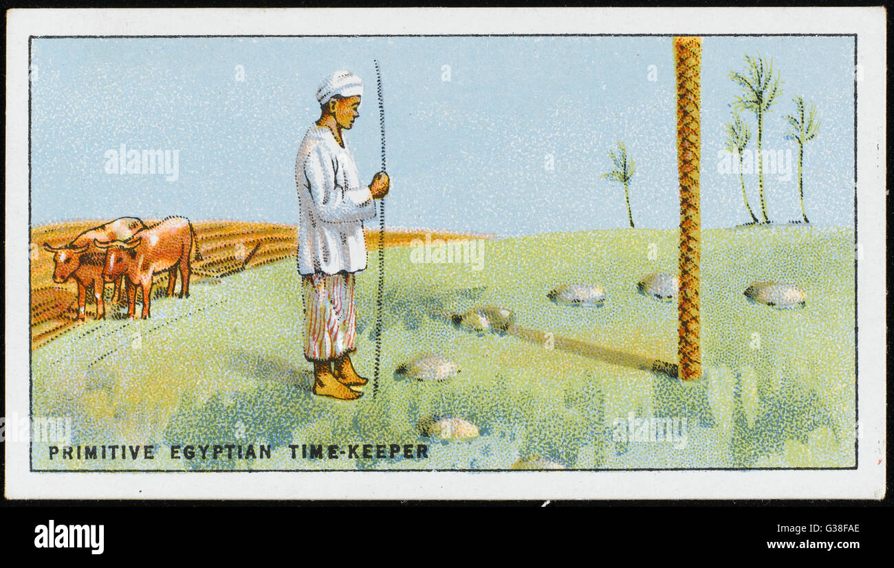 A primitive SUN DIAL, still  used in Upper Egypt, is simply  a pole stuck in the ground,  with stones marking the - Stock Image