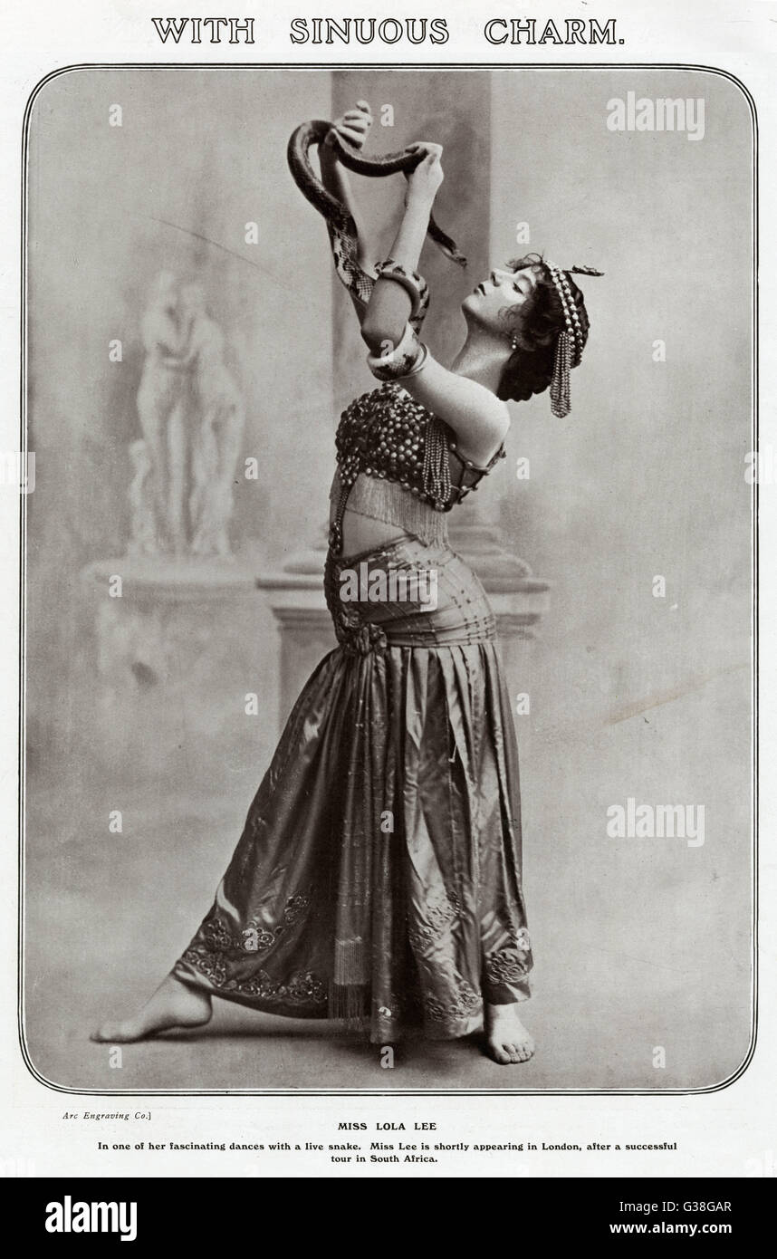 Dancer LOLA LEE is partnered  by a live boa constrictor        Date: 1909 - Stock Image