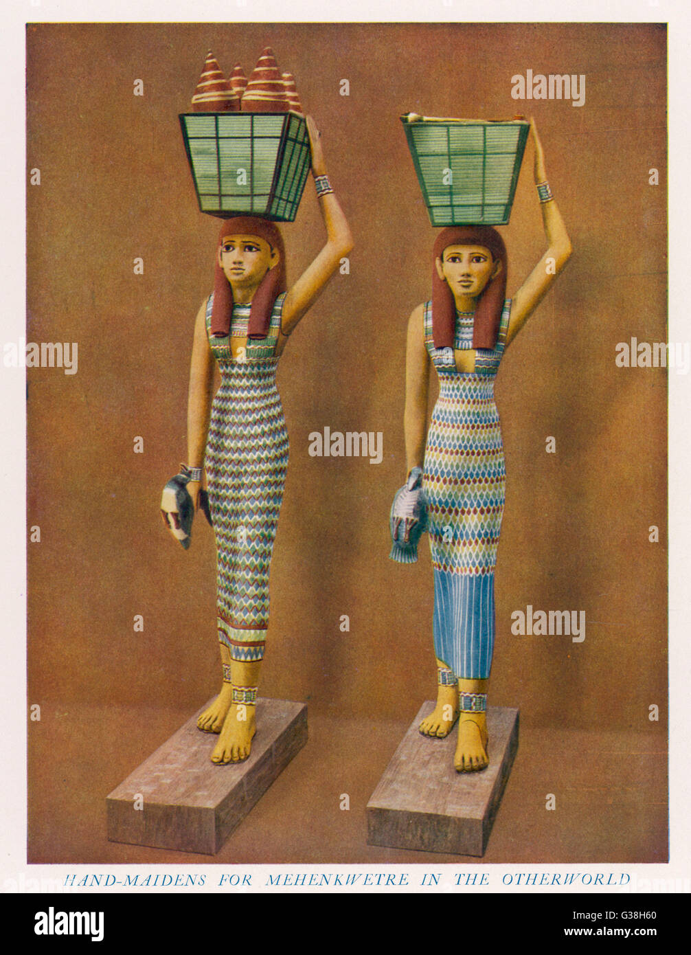 Two USHABTIS - half-sized  figurines placed in a  pharaoh's tomb ; these two  represent female attendants  carrying - Stock Image