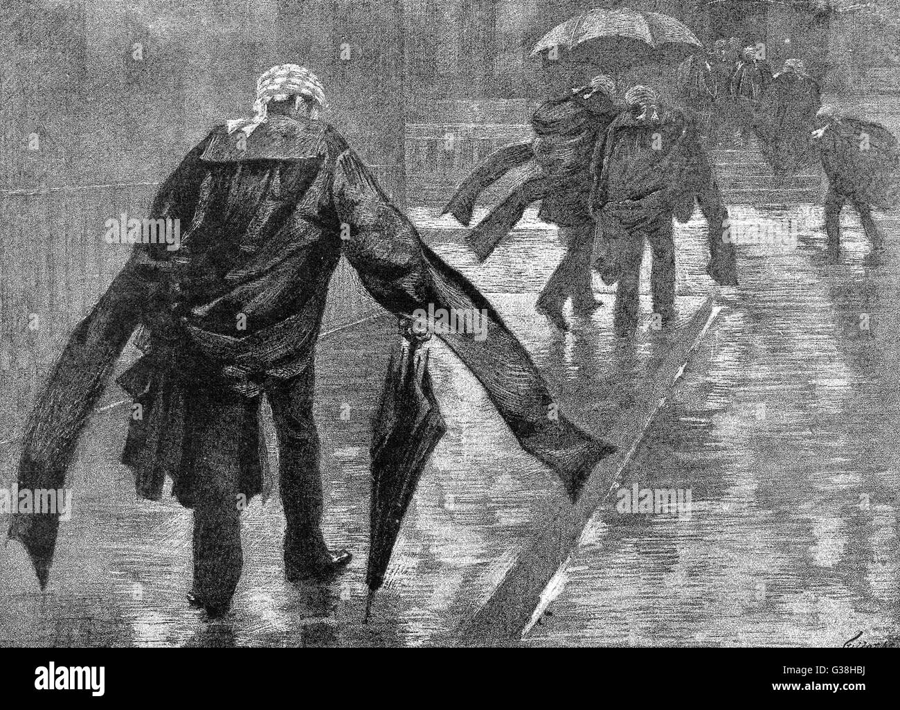 Barristers make their way  through the rain along Carey  Street from the Inns of Court  to the London Law Courts, - Stock Image