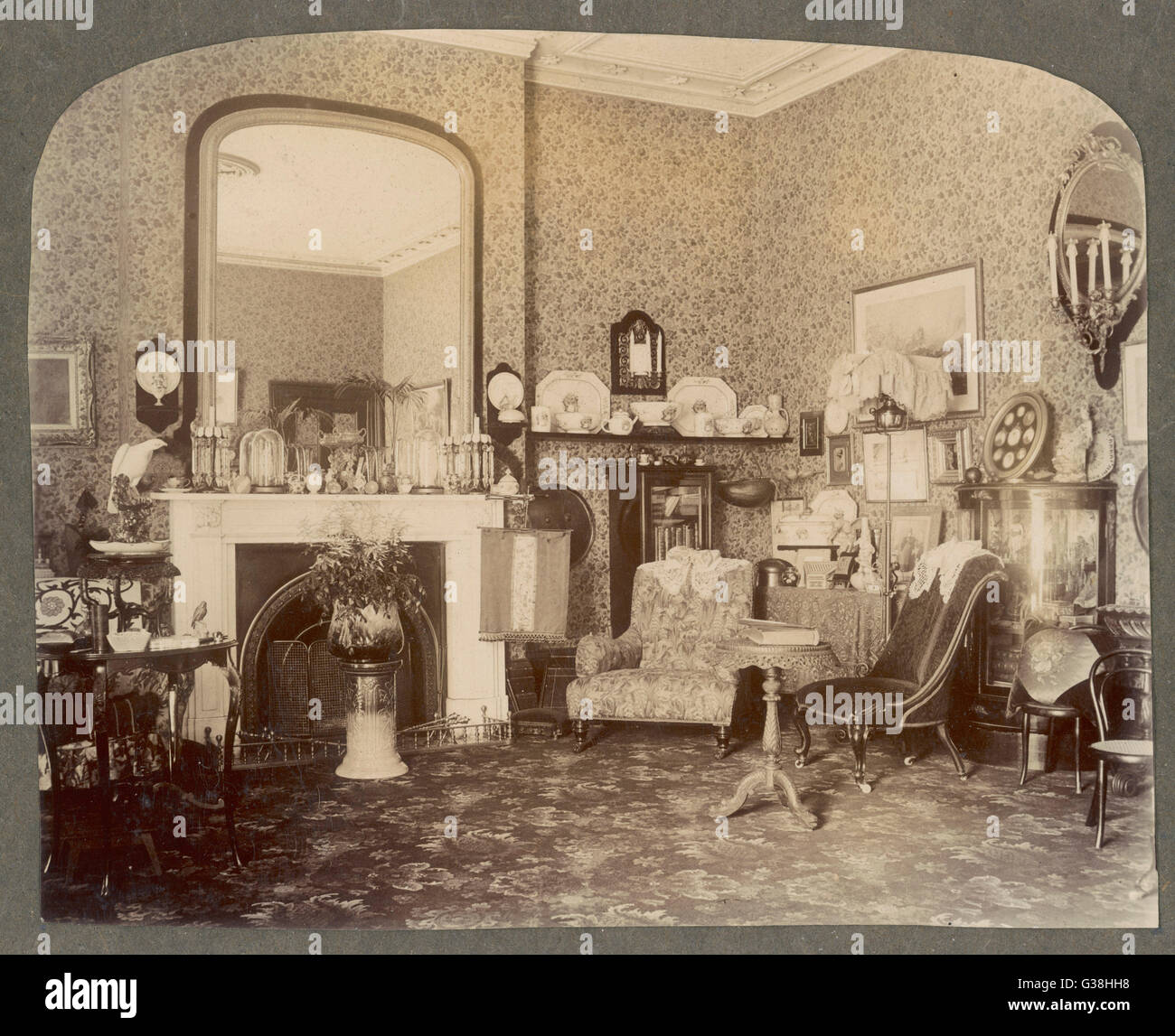 Victorian Sitting Rooms: A Victorian Sitting Room Date: Circa 1900 Stock Photo