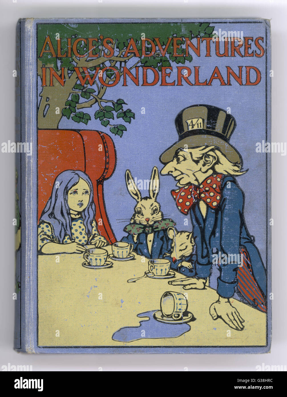 The Mad Hatter's Tea Party is  featured on the cover of the  1916 edition published by  Cassell        Date: - Stock Image