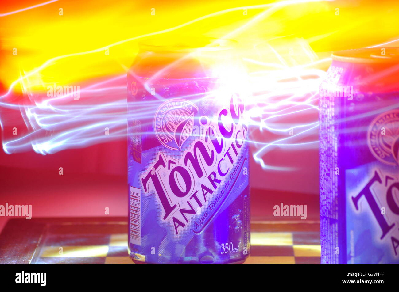 A can of soda with some light painting photo technique - Stock Image