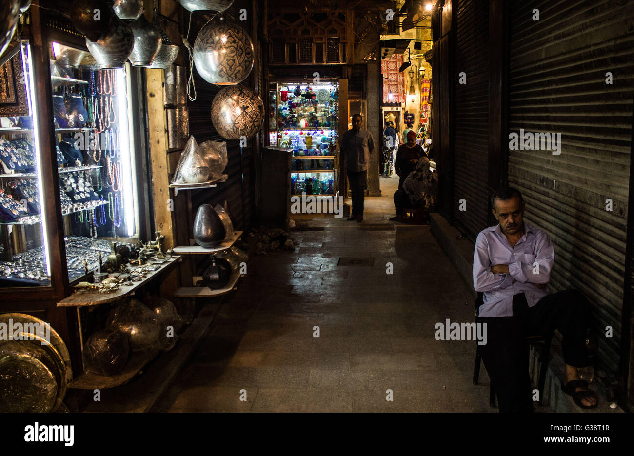 Cairo, Egypt. 9th June, 2016. A man sits in front of a shop lanterns in an area of Al-Azhar in Cairo.Lanterns and - Stock Image