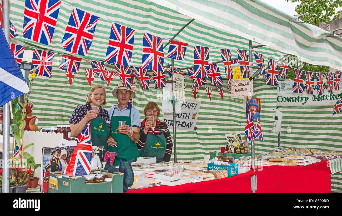 Staffordshire, UK. 10th June, 2016. Stall holders on Lichfield Country Market on the Market Square, Lichfield, Staffordshire, - Stock Image