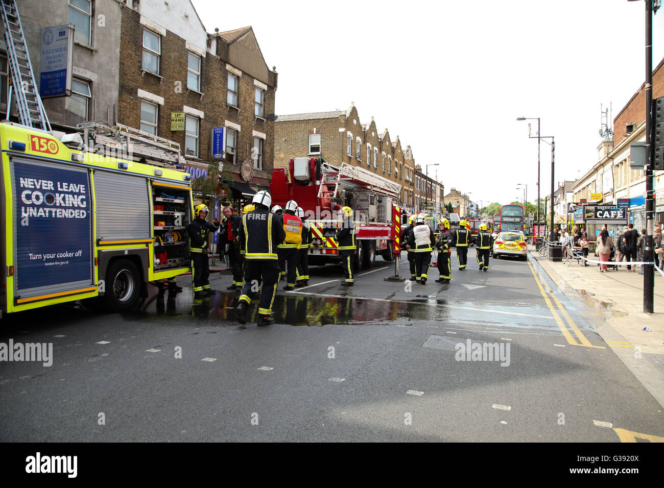 Harringay, North London 10 June 2016 Over 40 firefights, 8 fire engines attend a second floor flat over a cafebar - Stock Image