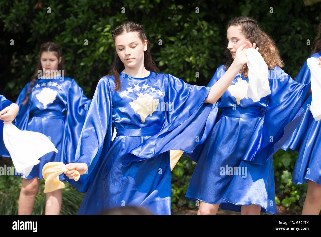 London Golders Green Childs Hill Park Albanian Community Childrens' Day Festival young teenagers blue dresses - Stock Image