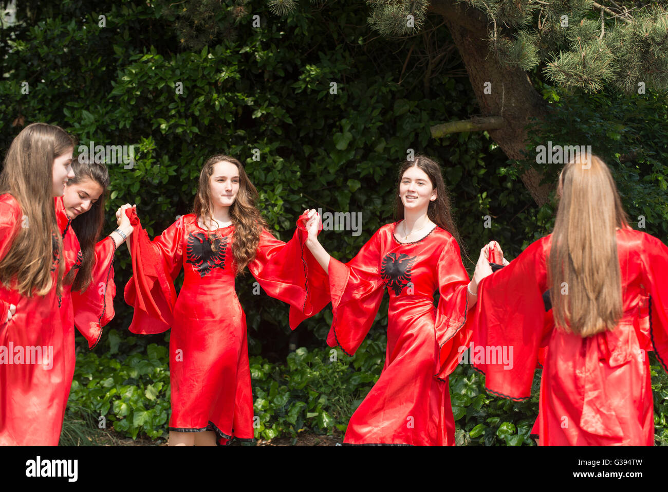 London Golders Green Childs Hill Park Albanian Community Childrens' Day Festival young teenagers red dresses - Stock Image