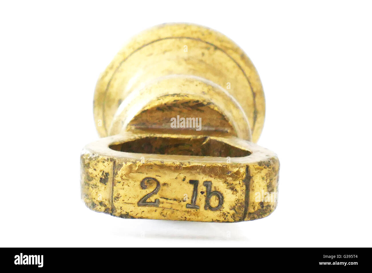 2 lb old fashioned Imperial brass weight which was used on traditional scales, pre metric - Stock Image
