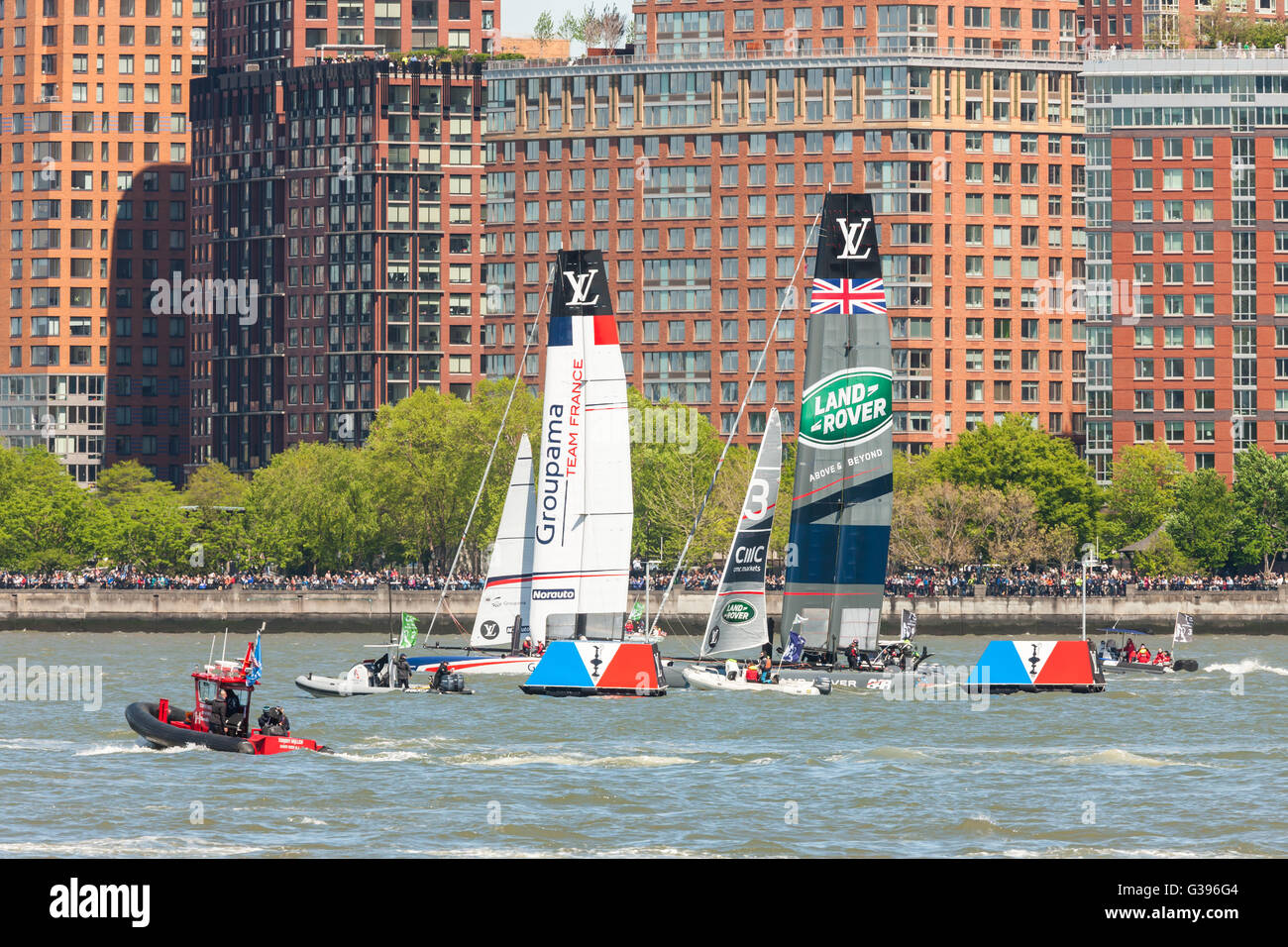 America's Cup World Series teams France and UK catamarans race on the Hudson River course near Brookfield Place. - Stock Image