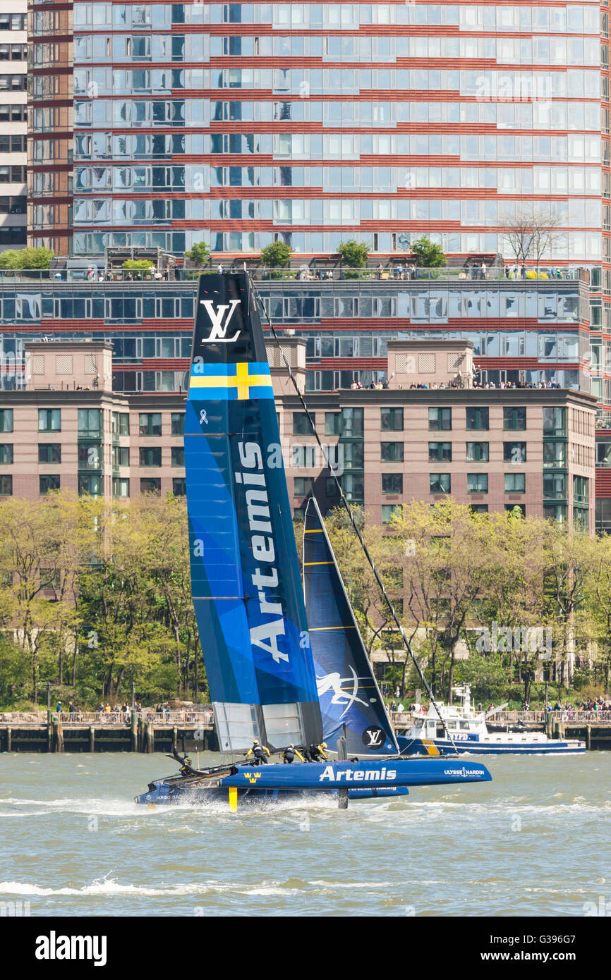 The Artemis Team Sweden catamaran races on the Hudson River near Brookfield Place in the America's Cup World Series. - Stock Image