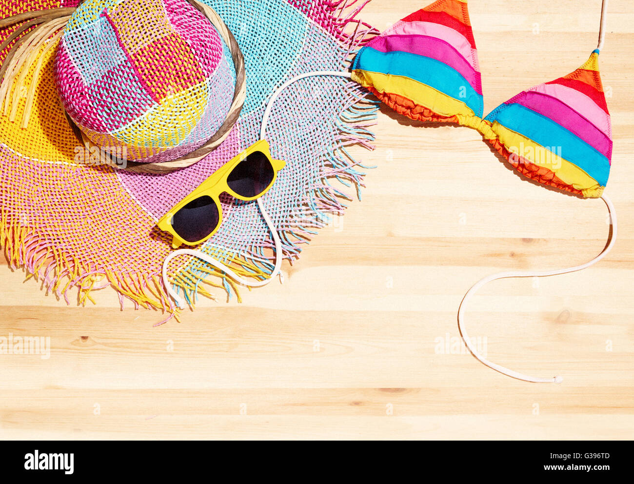 Summer fashion item on the wood table. With copy space for you - Stock Image