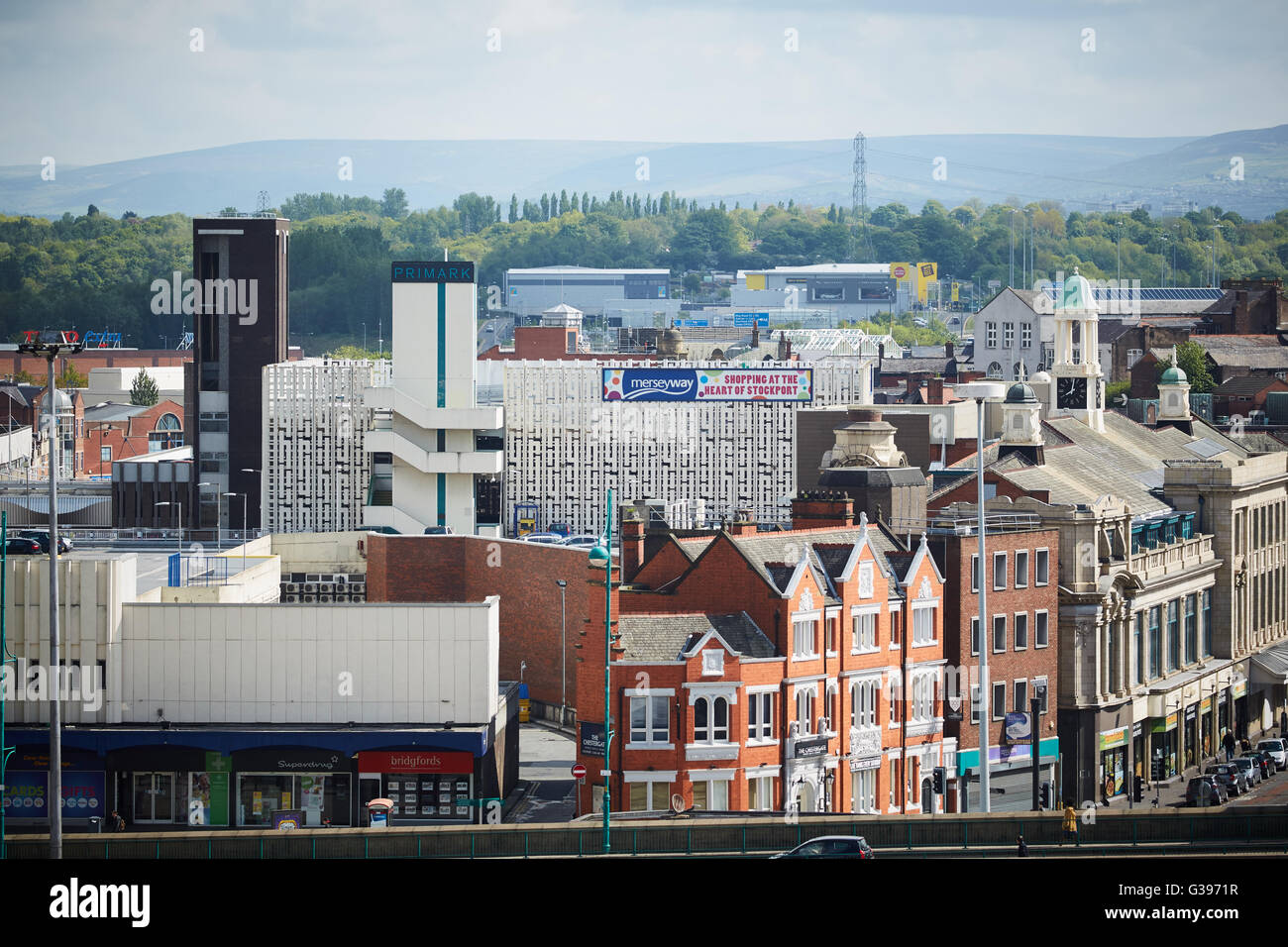 Stockport Merseyway shopping precinct town centre  Chester gate a6 road view beyond trees - Stock Image