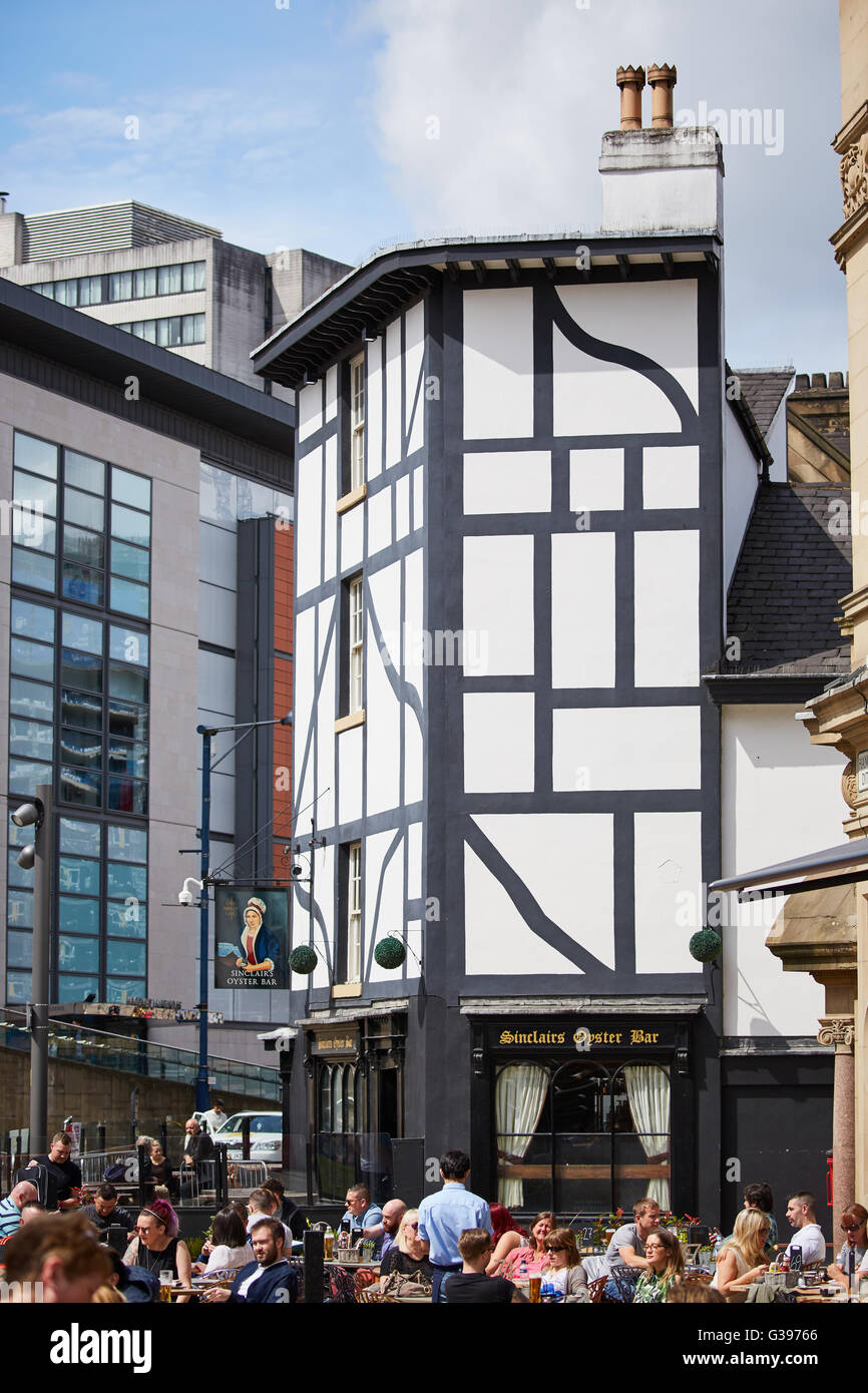 Shambles Square is a square in Manchester, England, created in 1999 around the rebuilt Sinclair's Oyster Bar - Stock Image