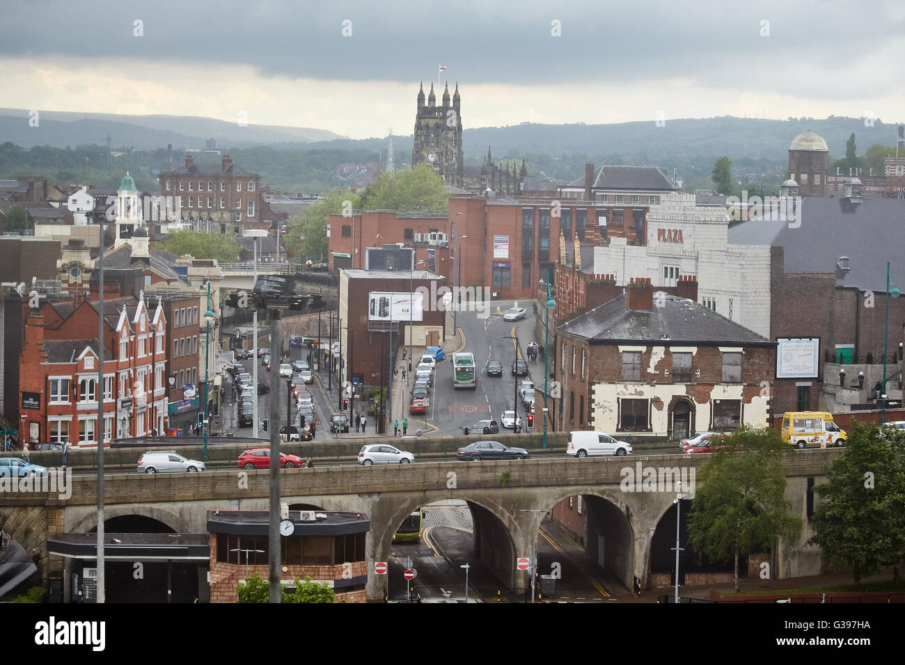 Stockport Merseyway shopping precinct town centre  Chester gate a6 road view beyond trees wet rain drizzle mist - Stock Image