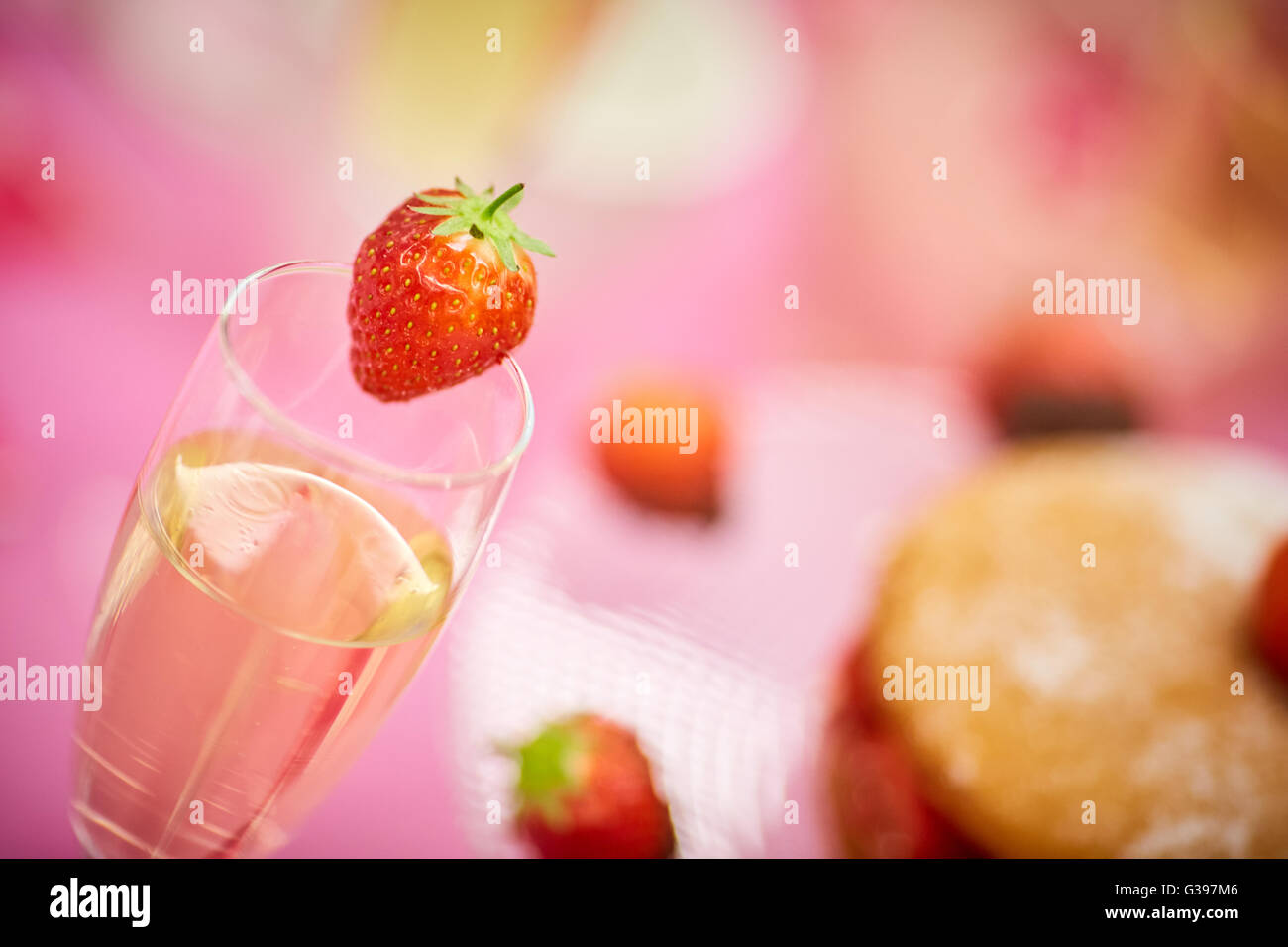 Strawberry wine cake chocolate dipped  Afternoon tea party picnic summer fruit red pink sponge glass decoration - Stock Image