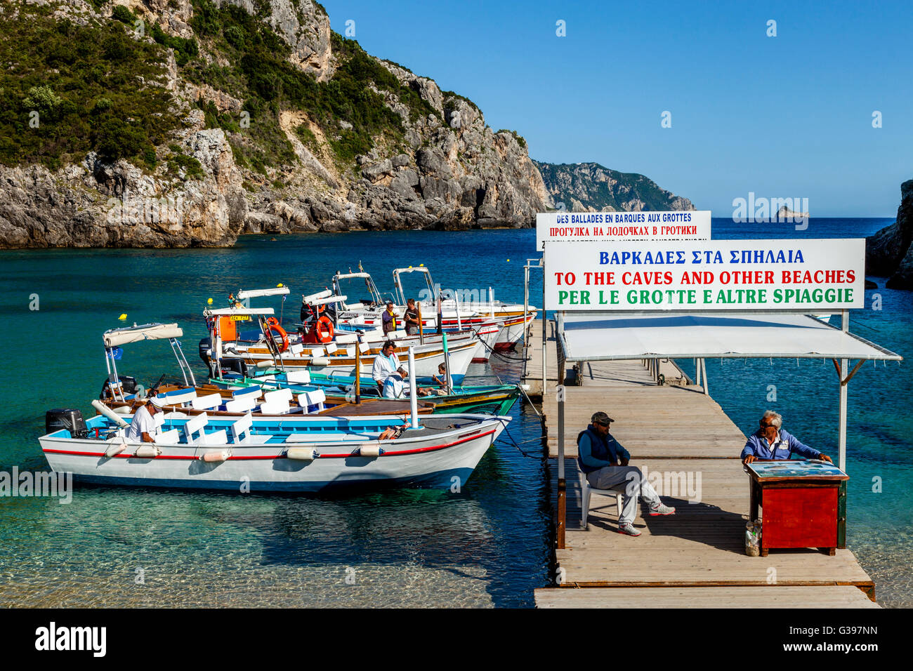 Local Boat Captains Waiting For Business, Paleokastritsa, Corfu Island, Greece - Stock Image