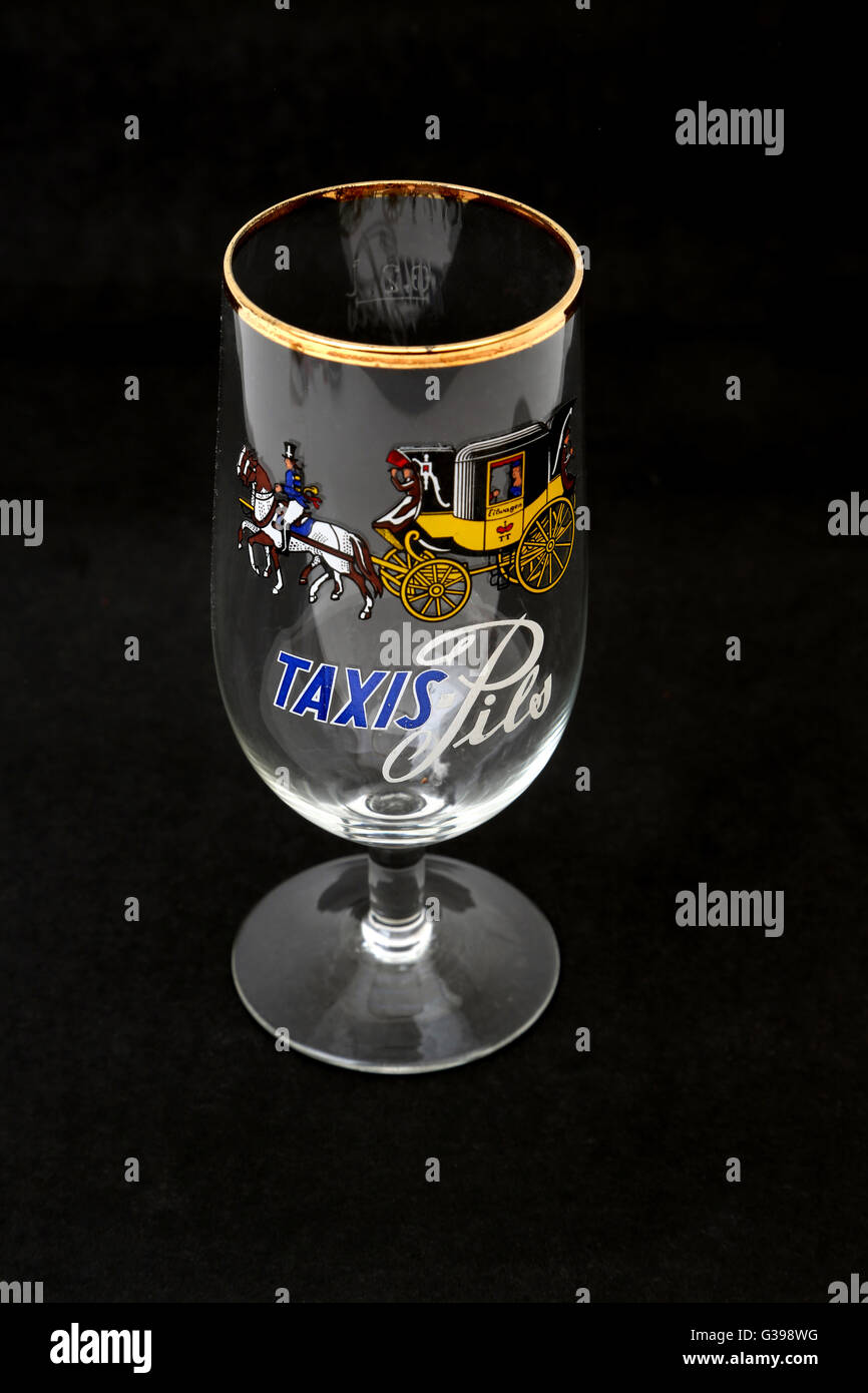 Taxis Pils German Glass With Gold Rim And Stem - Stock Image