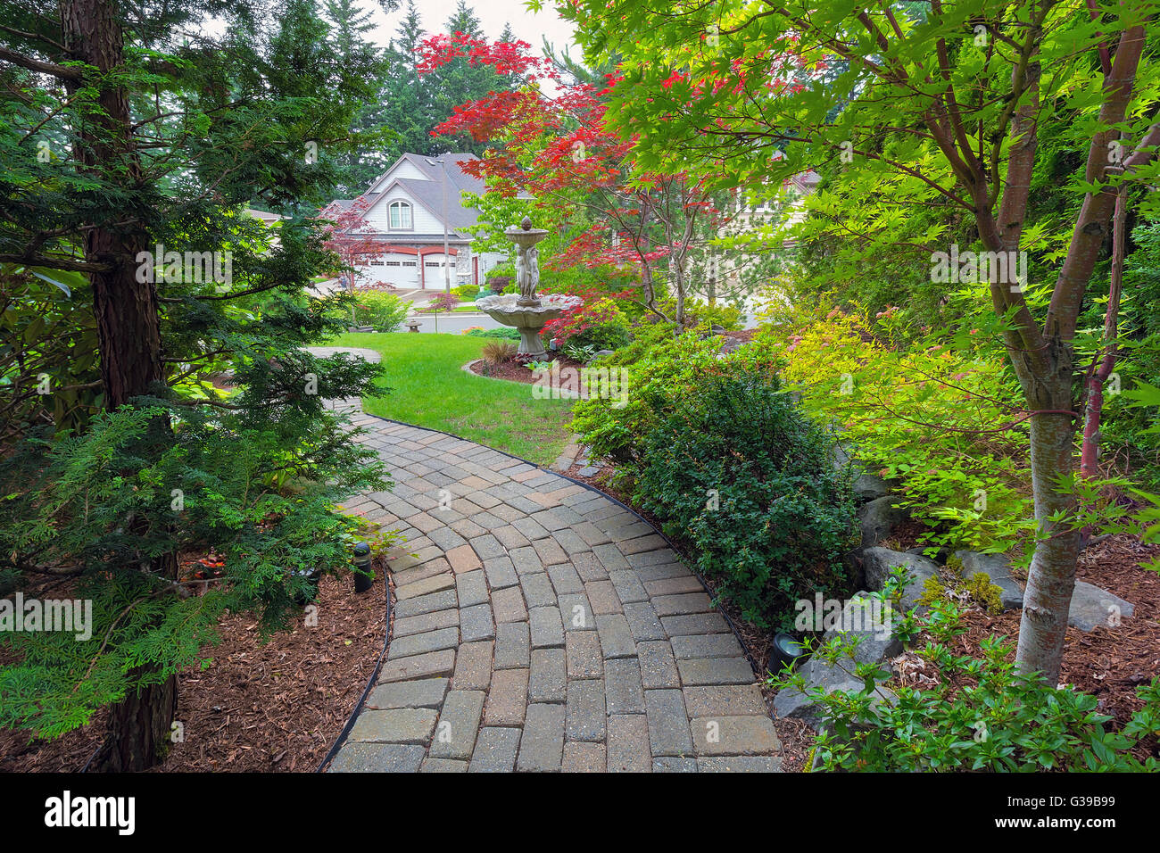 Garden Brick Paver Path In Frontyard With Water Fountain Plants